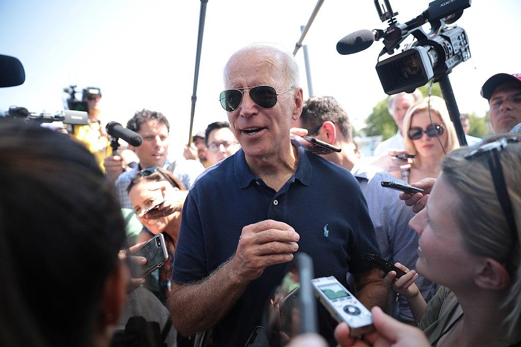 Joe Biden surrounded by journalists