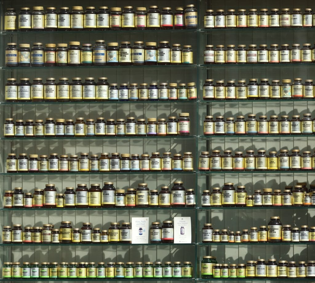 Wall filled with bottles of supplements
