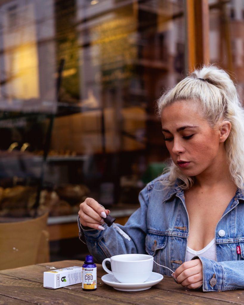 Woman with CBD tincture