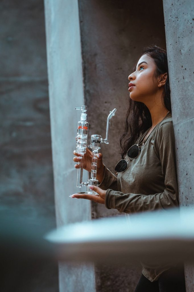 Woman holding water pipe